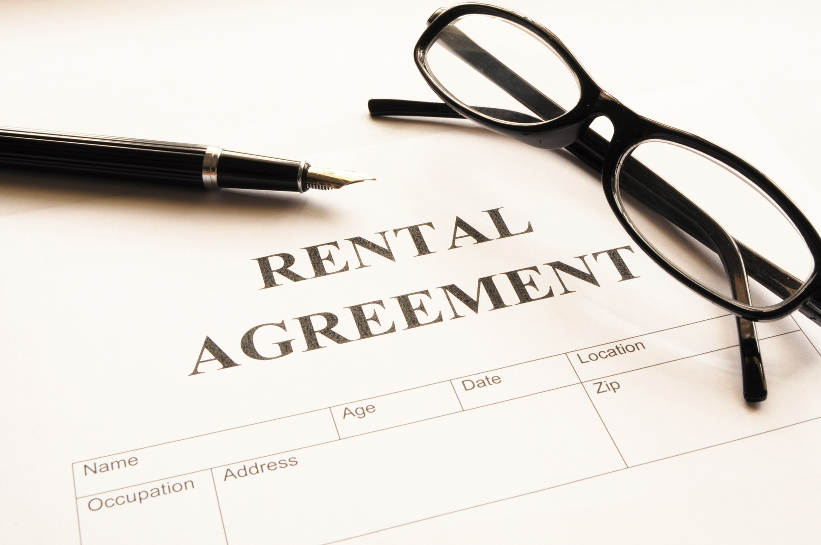 rental agreement form on desktop in business office showing real estate concept